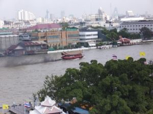 view of Bangkok and the river from one of the tallest temples