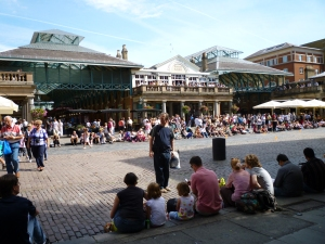 crowd watching a performer in Covent Garden
